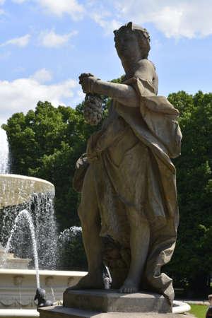 allegoric: Allegoric figure near the fountain in Saxon garden