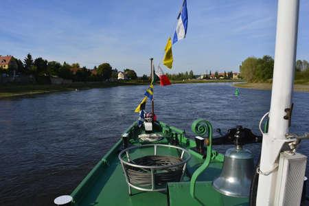 elba: Ship sailing down the river Elba