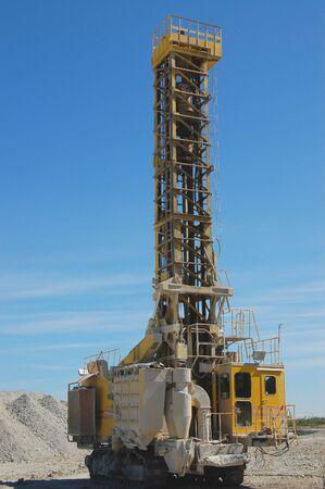 Heavy drilling machine in open pit Stock Photo