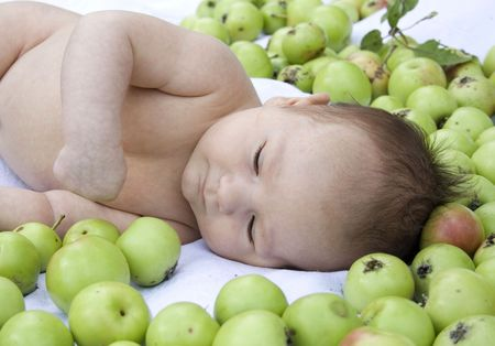 portrait of a newborn dreaming among apples Stock Photo - 3640937