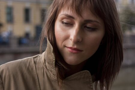 Portrait of young beautiful woman in raincoat Stock Photo - 3640916
