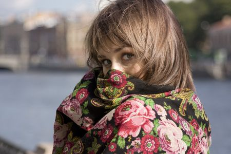 Portrait of young beautiful woman hiding in shawl Stock Photo - 3640923