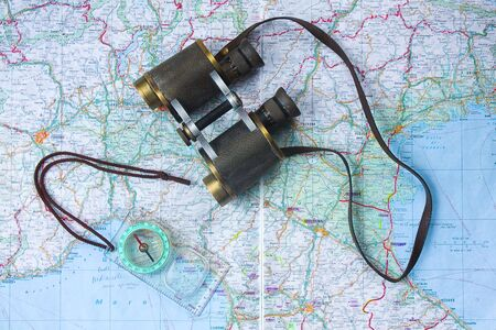Binocular and compass on a map