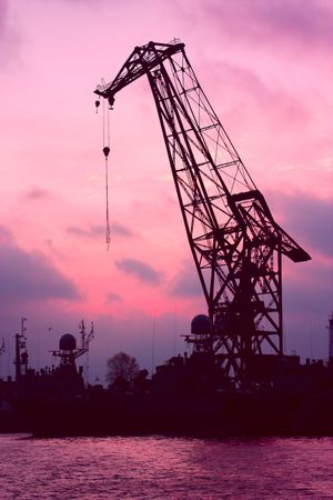 Silhouette of a crane in a dock