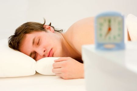 young handsome  man sleeping in his bedroom Stock Photo