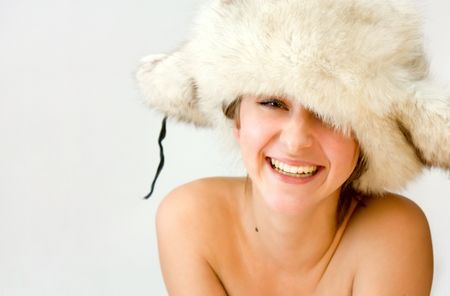 portrait of young beautiful woman in cap with ear flaps Stock Photo