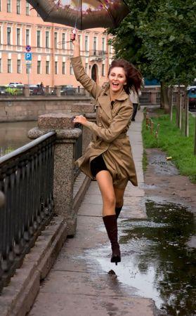 Yong woman with umbrella Stock Photo