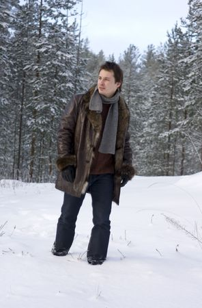 young man walking in forest photo