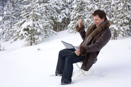 young man with laptop outdoors Standard-Bild