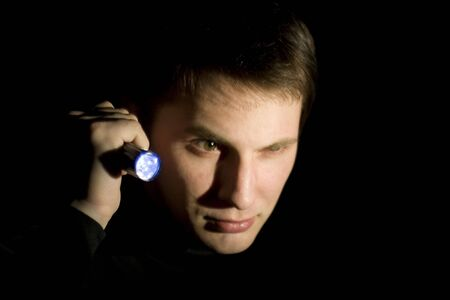 young man looking for something in the dark Stock Photo