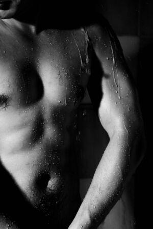 brawny man taking shower closeup