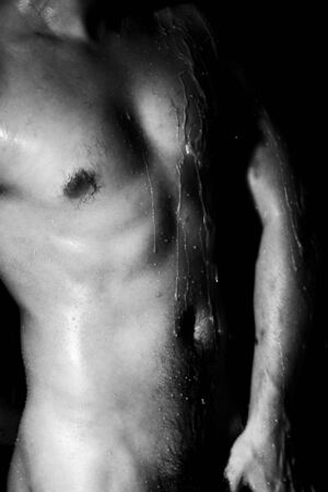 browny man taking shower closeup