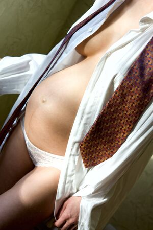 pregnant woman in shirt and necktie photo