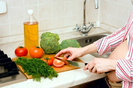pregnant woman preparing healthy food