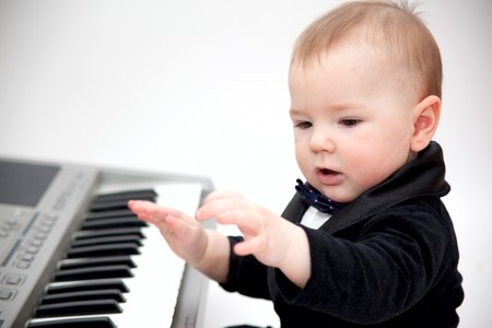 little boy in tailcoat playing piano Standard-Bild