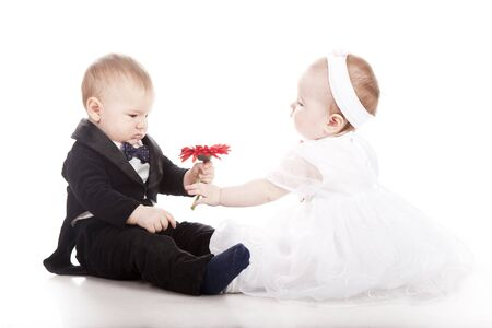 baby in suit: little boy and girl playing wedding Stock Photo