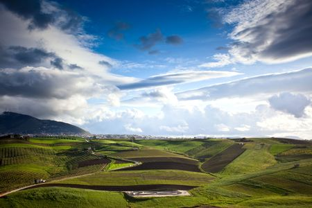 beautiful sicilian landscape of cultivated fields