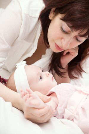 happy mother lying with her newborn daughter Stock Photo - 4817701