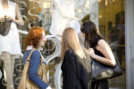 three women at the shop window photo