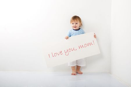 cute little boy with a message to mother