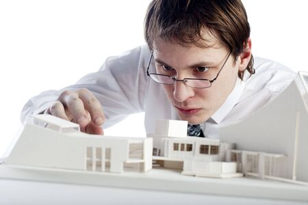 architectural architect: young architect making architectural model