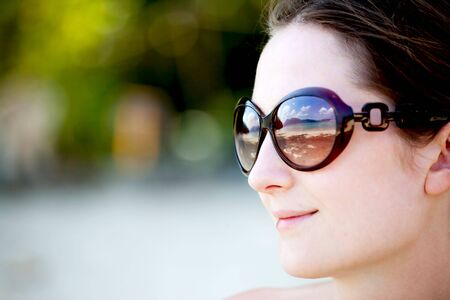 portrait of young woman in sunglasses with reflection of the sunny beach Stock Photo - 6736314