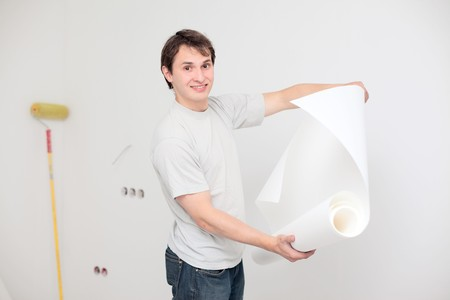 young happy man making renovation of his apartment photo