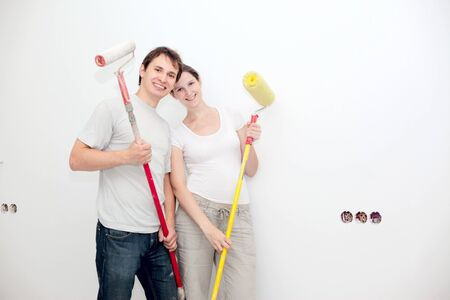 happy young couple making renovation in their apartment Standard-Bild