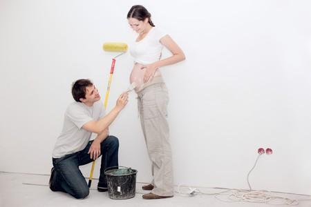 happy young couple waiting baby making renovation in their apartment Standard-Bild