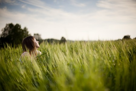 young woman enjoying beauty of the nature