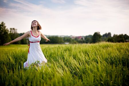 happy young woman enjoying nature Standard-Bild
