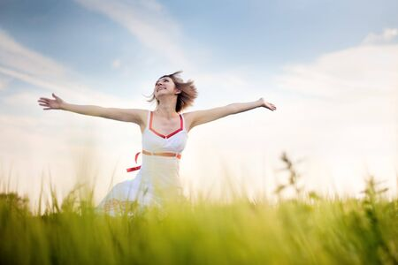happy young woman enjoying nature Stock Photo - 7755517