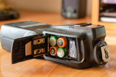 A side view of open the battery compartment. Selective focus. Eye level shooting. Close-up. Blurred background.