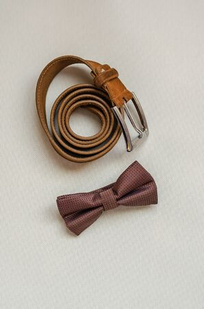Brown set of clothing accessories for sophisticated men. View from above. Selective focus. Portrait photo location.