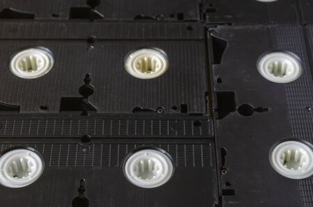Real Old Videotapes Background. Full frame video cassettes. Creative background. Close-up. Eye level shooting. Selective focus.