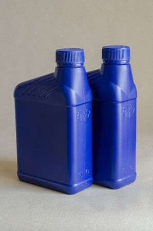 Two blue plastic canister for lubricants without label, container for chemicals.1 liter plastic containers. Close-up. Selective focus. Stock Photo