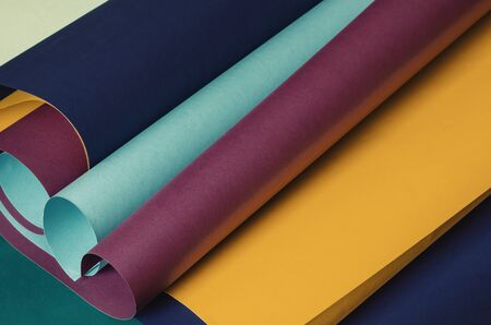 Scrolls of colorful paper in pastel colors. Creative multitask background for various design tasks. Copy space. Selective focus.