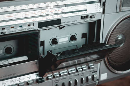 Close-up of a retro stereo cassette recorder. Vintage audio equipment of the last century. Selective focus.