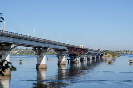 Automobile drawbridge across the Southern Bug River. A unique reinforced concrete bridge with a swing section. Hydraulic structures. Stock Photo