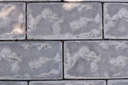 Flat lay gray cobblestone pavement. Full frame of texture of gray stone on the sidewalk. Abstract background. Banque d'images