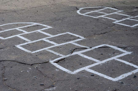 Blank template for Hopscotch on the asphalt. Drawn blanks for playing on asphalt. Primary school courtyard. Without anyone.