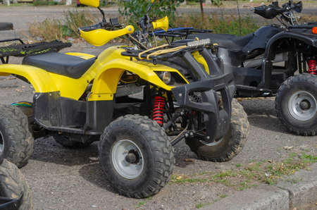 Group of random quad bikes in line outdoors. Rent of transport for off road trips. Active rest, adventure.