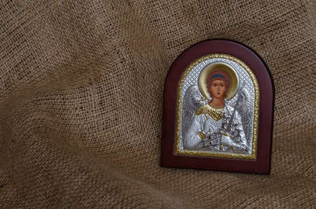 Christian icon of the Archangel Michael with silver and gilding. The inscription in Russian is translated: holy guardian angel. Attributes Orthodox Church.