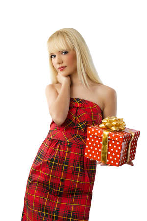 Beautiful young blonde girl holding christmas gift in red dress on white background Stock Photo