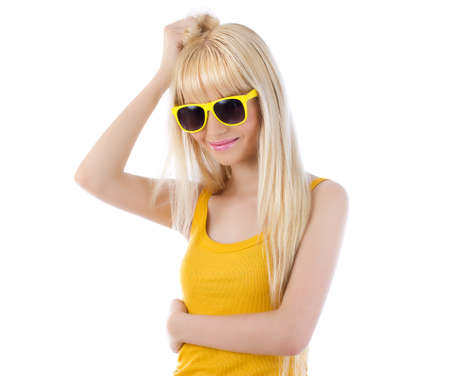 flirtatious: Side view of flirtatious woman wearing sunglasses against white background