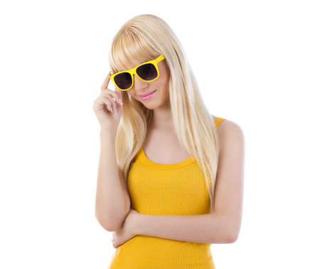 Woman holding brim of glasses on white background Stock Photo