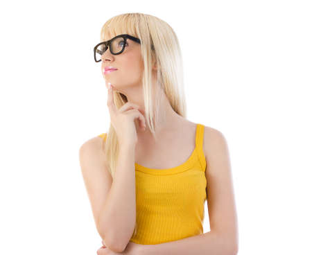 Woman in glasses daydreaming on white background