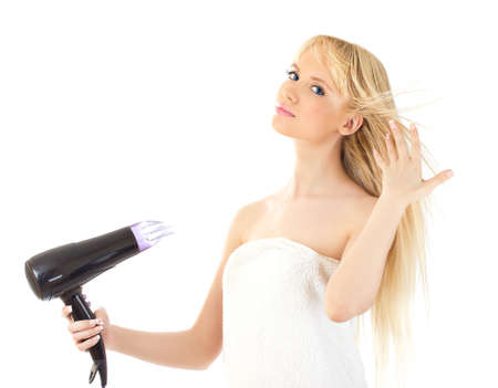 Portrait of beautiful woman holding hair dryer over white Stock Photo