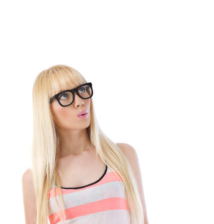 Pretty woman in glasses looking up at copyspace over white Stock Photo