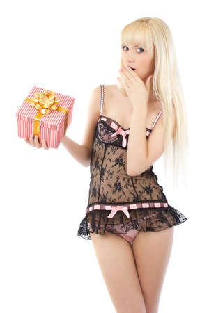young female: Beautiful young girl in sexy pink lingerie with gift box on white background